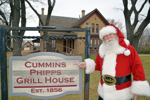 Santa in front of cummins house sign